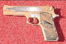 pistol covered in rust